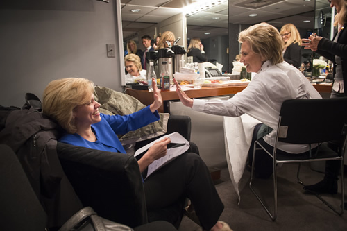 SNL star Kate McKinnon, known for her impersonation of Sec. Clinton, and Sec. Clinton share a high five after going over the script for that evening's broadcast.