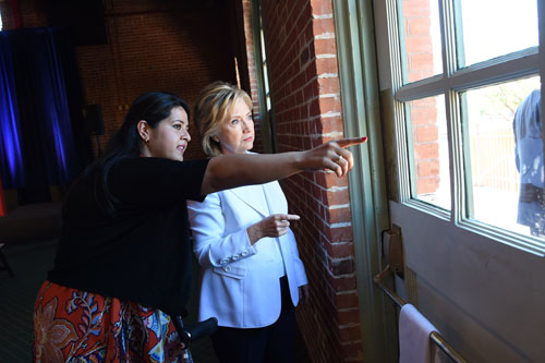 Lorella Praeli, National Latino Vote Director for HFA (Hillary for America) gives direction to Sec. Clinton for her entrance onto the stage at a rally in San Antonio, TX on October 15, 2015.