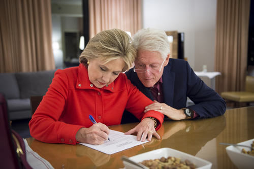 With the Iowa democratic debate little more than a few weeks away, Bill peaks over Sec. Clinton's shoulder as she works on her talking points.