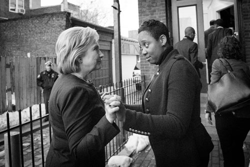 Sec. Clinton gets a quick briefing from the Hillary Campaign's National African American Outreach Director LaDavia Drane before entering Mother Bethel A.M.E. Church in Philadelphia, PA on January 27, 2016. Clinton was meeting with top ministers from across the nation.