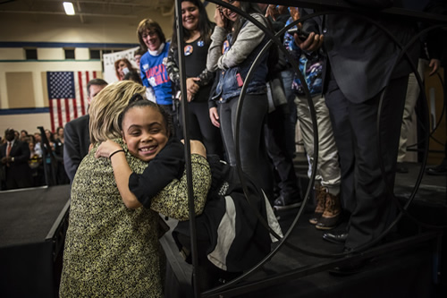 A young girl gives Sec. Clinton a hug at a campaign event in Chicago.