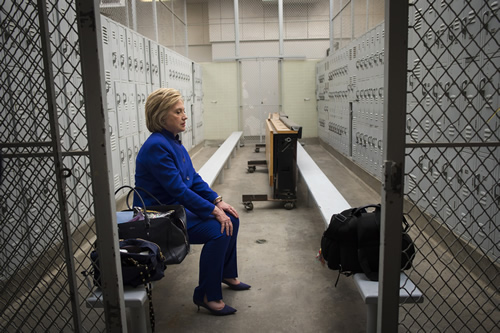 In a locker room prior to a rally in Long Beach, Sec. Clinton finds a rare quiet moment.