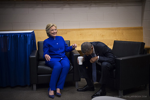 President Obama and Sec. Clinton laugh loudly at something they were discussing prior to Sec. Clinton accepting the nomination at the Democratic National Convention in Philadelphia.