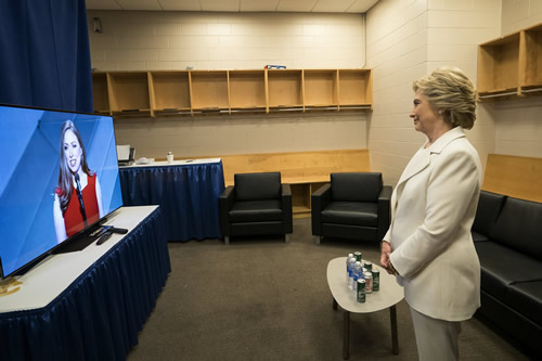 Sec. Clinton watches on a monitor in a room backstage as daughter Chelsea Clinton introduces her prior to her accepting the nomination as the democratic candidate for president.