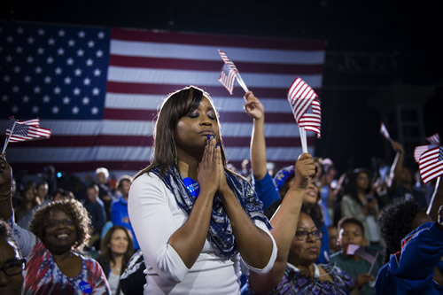 A young woman listens quietly to Sec. Clinton's speech at a campaign rally in Raleigh, N.C..