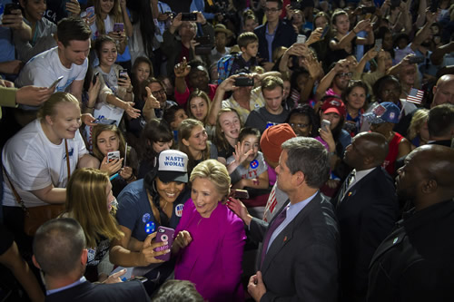 A picture of two 'nasty women', Sec. Clinton poses for a selfie with a supporter at a campaign rally in Raleigh, N.C..