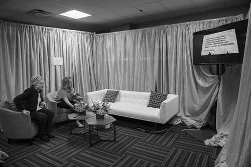 On the Friday before the election, Sec. Clinton and HFA's Director of Communications, Jennifer Palmieri, laugh backstage as a live feed from a Beyonce and Jay-Z concert displays Sen. Clinton's famous quote from 1992 about staying home and baking cookies. Beyonce chose to display the quote as a sign of strength.