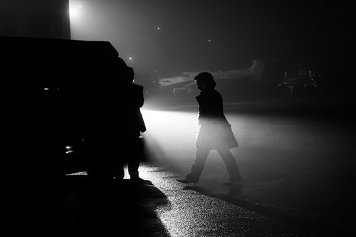 Sec. Clinton quickly makes her way from the plane to a waiting SUV on a foggy night in Westchester, New York.